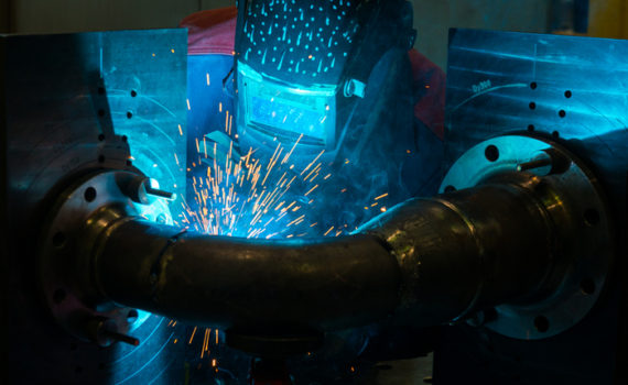 Professional welder working with steel structures - Industrial Worker at the factory